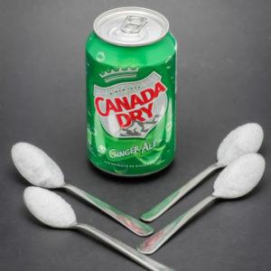 1 canette de 33cl de Canada Dry contient 3,7 cuil. à café de sucre
