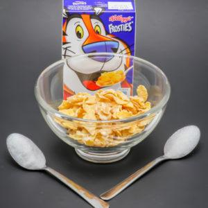 25g de Frosties sans lait contiennent 1,9 cuil. à café de sucre