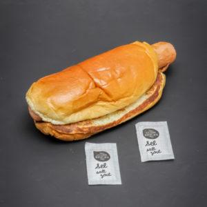 1 P'tit hot dog Mcdonald's contient 2 dosettes de sel soit 1,6g
